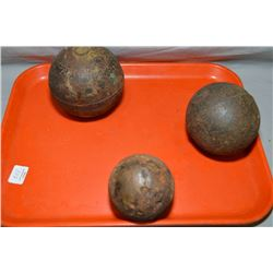 Three antique cannon balls
