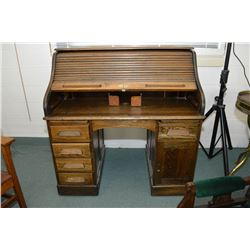 "Antique double pedestal ""S"" curved roll top desk with pigeon hole interior, note disassembles for ea"