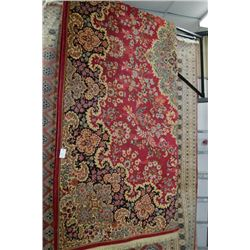 Large wool area rug with center medallion, wide border, with red background and highlights, in teal,