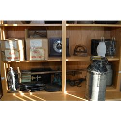 Two shelf lots of collectibles including lamp globes, cream cans, sadiron, battery boxes, scales etc