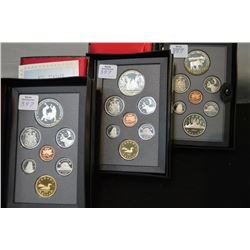 Three cased Canadian double dollar proof sets including 1985, 1988 and 1989