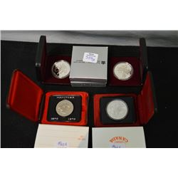 Four cased Canadian silver dollars including 1970 Manitoba, 1975 Calgary, 1990 Kelsey Expedition, 19