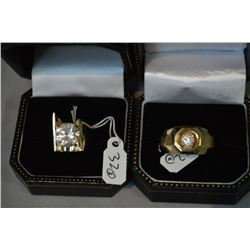 Two 14kt yellow gold rings with cubic zirconia gemstones