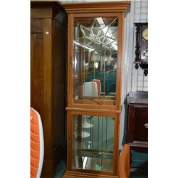 "Modern illuminated two door curio cabinet with leaded and bevelled panels and glass shelves, 24"" in"