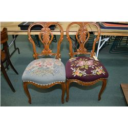 A pair of delicate antique hand carved side chairs with needlework upholstered seats