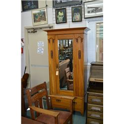 Single door antique Nouveau influenced wardrobe with hand carved panels and single drawer in base