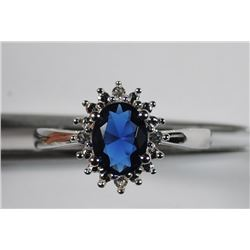 CLASSIC PRINCESS DIANA STYLE RING, FANTASTIC OVAL CUT LAB SAPPHIRE CENTER