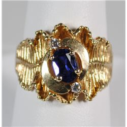 14 K YELLOW GOLD RING, BLUE OVAL CENTER STONE APPROX. .75 CT, TESTS DIAMOND