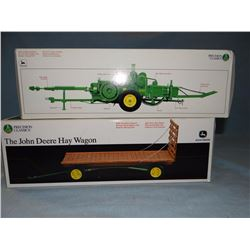 2 toys: JD 214T twine tie baler, 1:16, NIB and JD Hay wagon, 1: 16, NIB