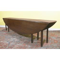a mahogany ten foot drop leaf hunt table, 18th century, the oval drop leaves on grooved gate l...