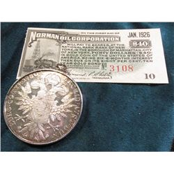 "1780 Maria Theresa Silver Thaler in a bezel and with a Jan. 1926 ""Norman Oil Corporation"" $40 Nation"
