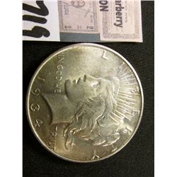 1934 D U.S. Peace Silver Dollar. Brilliant Uncirculated.