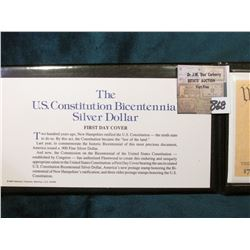 "Fleetwood folder with ""The U.S. Constitution Bicentennial Silver Dollar and First Day Cover."
