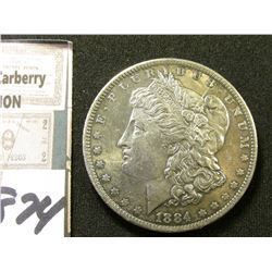 1884 O Morgan Silver Dollar. Toned unc.