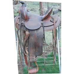 Marshall Wells border tooled high back saddle