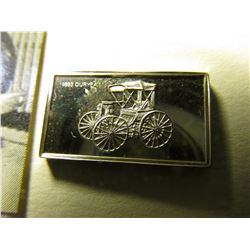 "Sterling Silver Bar ""1893 Duryea"", 17mm x 10mm; & an advertising Card ""Own a Late Model 1937 Oldsmob"