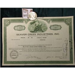 "1922 P U.S. Peace Silver Dollar, Brilliant Uncirculated; & 1968 Stock Certificate ""Beaver Creek Indu"