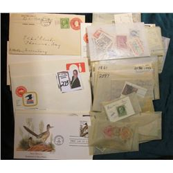 Approximately (55) packets of used U.S. and foreign stamps, (16) First Day and miscellaneous letters