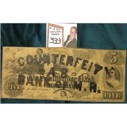 "Cancelled in brown Ink ""Counterfeit A.B. Bank of M.A."" Southridge, Mass. Five Dollar note."