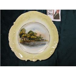 "Small China Saucer depicting Lake with docks scene ""Lake Wood Landing/Lake View, Iowa""."