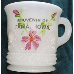 "Milk Glass Cup ""Souvenir of Tama, Iowa."" Floral design. No chips or apparent damage."