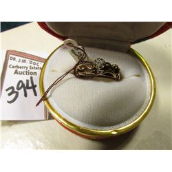 Ladies 10K Gold Ring with a .10 carat Genuine Diamond in a Japanese silk covered box.