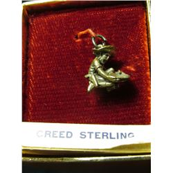 "Sterling Silver Charm ""Old Prospector Panning Gold"", new in box, labeled ""Creed Sterling""."