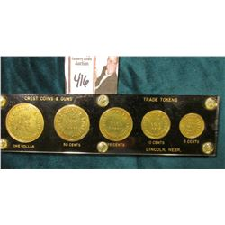 "Five-Piece Token Collection in a Capital holder, black with gold lettering ""Crest Coins & Guns/Buy/S"