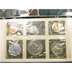 1961 U.S. Proof Set Cent to Half-dollar in a fancy plastic case with gold lettering.