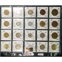 (20) Different World Coins in a plastic page. All Different and attributed. Includes Jamaica, Japan,
