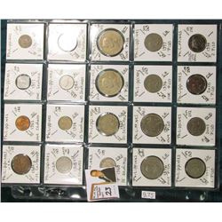 (20) Different World Coins in a plastic page. All Different and attributed. All Philippines Islands.