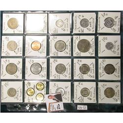 (20) Different World Coins in a plastic page. All Different and attributed. Includes Switzerland, Th