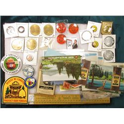 "12"" x 16"" Glass frame full of Smokey the Bear items including Iowa Gas & Electric Co. Medals; Rulers"