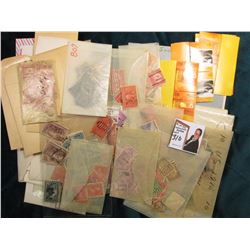 Large Group of mostly cancelled Postage Stamps, the majority of which are U.S., with a few foreign.