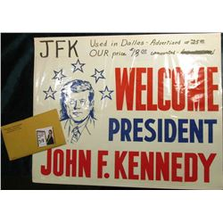 "Plastic Cellophane Window sign Used in Dallas, Texas in 1963 ""Welcome President John F. Kennedy""; &"