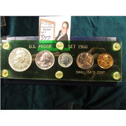 1960 Small Date U.S. Proof Set in a green Capital holder with gold lettering. Cent to Half-Dollar.
