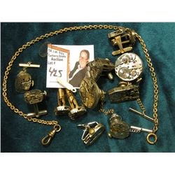 Watch Collectors Gems: Small Watch Chain; Watch Crystal; (7) Watch Movement Tie Pins or Clasps; & (3