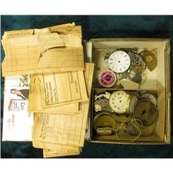 "Small tin ""Waltham"" Box with old envelope from Henry Paulson & Co.; & a large group of watch parts i"