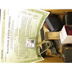 "Old Watch Bands, Boxes, & (2) Stock Certificates for 100 Shares of ""Waltham watch Company"" Stocks."