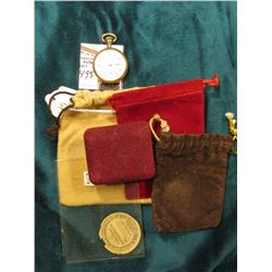 "Inside advertising label ""Duebner"" Watch Case Manufacturing; (3) Felt bags and a ring box; & a small"