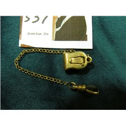 Gold filled watch chain with attachment.