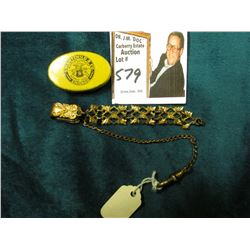 Scroll figured Watch Fob. Gold-filled; & a Swartchild & Co. Chicago Watch Part tin.