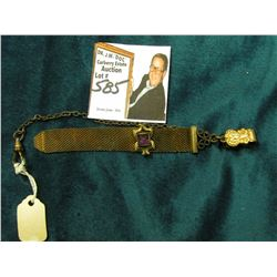 Wire mesh Watch fob with gold-filled attachments one of which has an Amethyst inset.