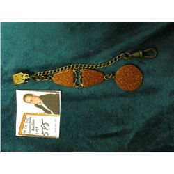 Antique Watch Chain with three Gold Stone framed sets.