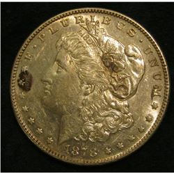 1878 S Morgan Silver Dollar. AU-Unc with a few toning spots.