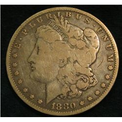 1880 0 Morgan Silver Dollar. VG.