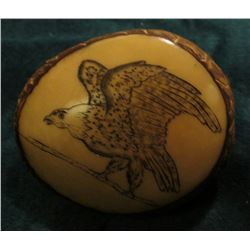 Polished and Engraved Palm Nut with Eagle design.