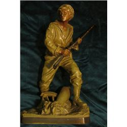 Hollow Bronze of a World War I French Infantryman with Bolt Action Rifle. He is stepping over an exp