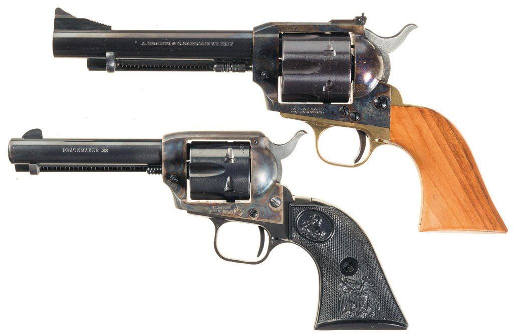two single action revolvers with cases a uberti iver johnson