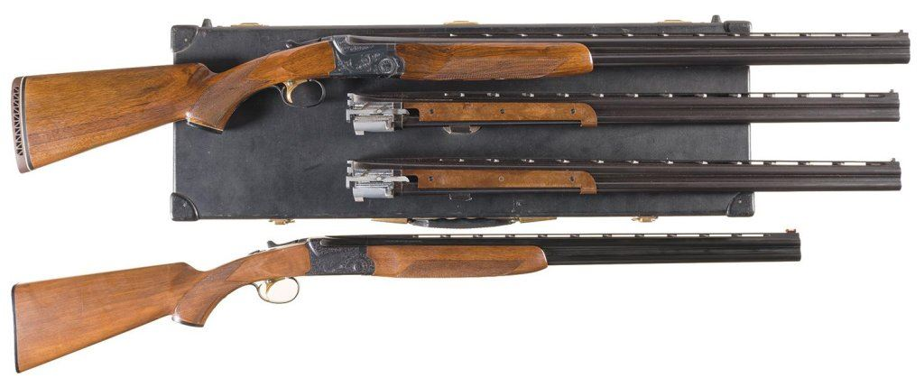 Two overunder shotguns a engraved ithacaskb three barrel set image 1 two overunder shotguns a engraved ithacaskb three thecheapjerseys Gallery